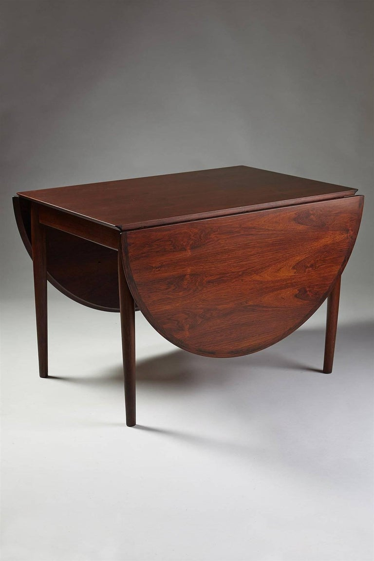 Dining table designed by Arne Vodder for Sibast, Denmark, 1958  Rosewood.
