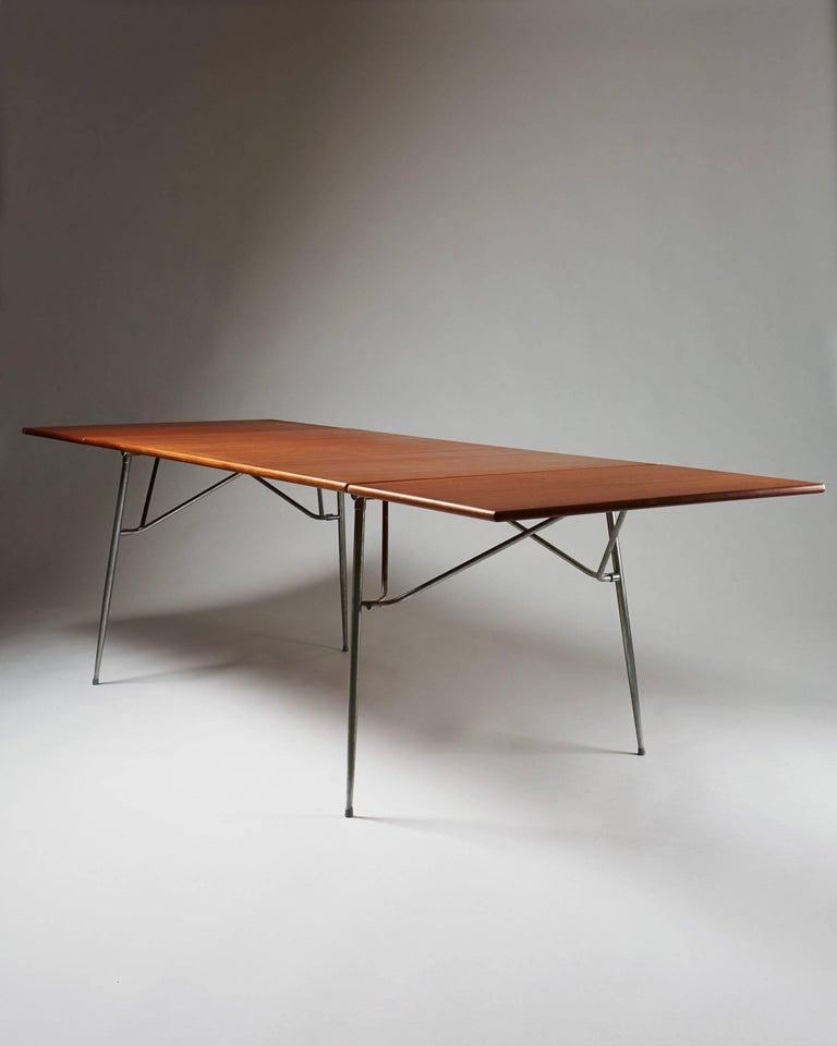 Dining table designed byBørge Mogensen for Søborg, Denmark, 1952. Teak and steel.  Measures: H 73 cm/ 28 3/4'' L 140 cm/ 4' 7'' Length when extended 240 cm/ 7' 10 1/2'' D 90 cm/ 35 1/2''.
