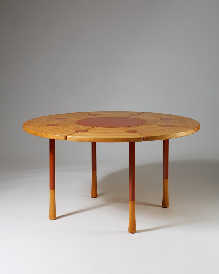 Dining table designed by Richard Nissen,  Denmark.  Beech with metal inlays.  Measures: H 73 cm/ 2' 5 1/2'' D 140 cm/ 4' 7 5/8'.