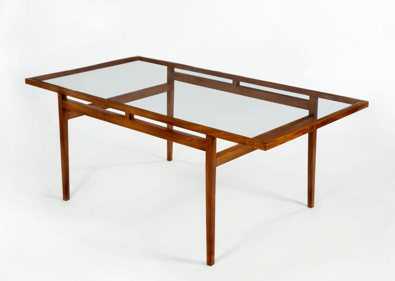 Dining table with frame in solid rosewood with glass top. Designed for Branco and Preto, Brazil, 1950s.