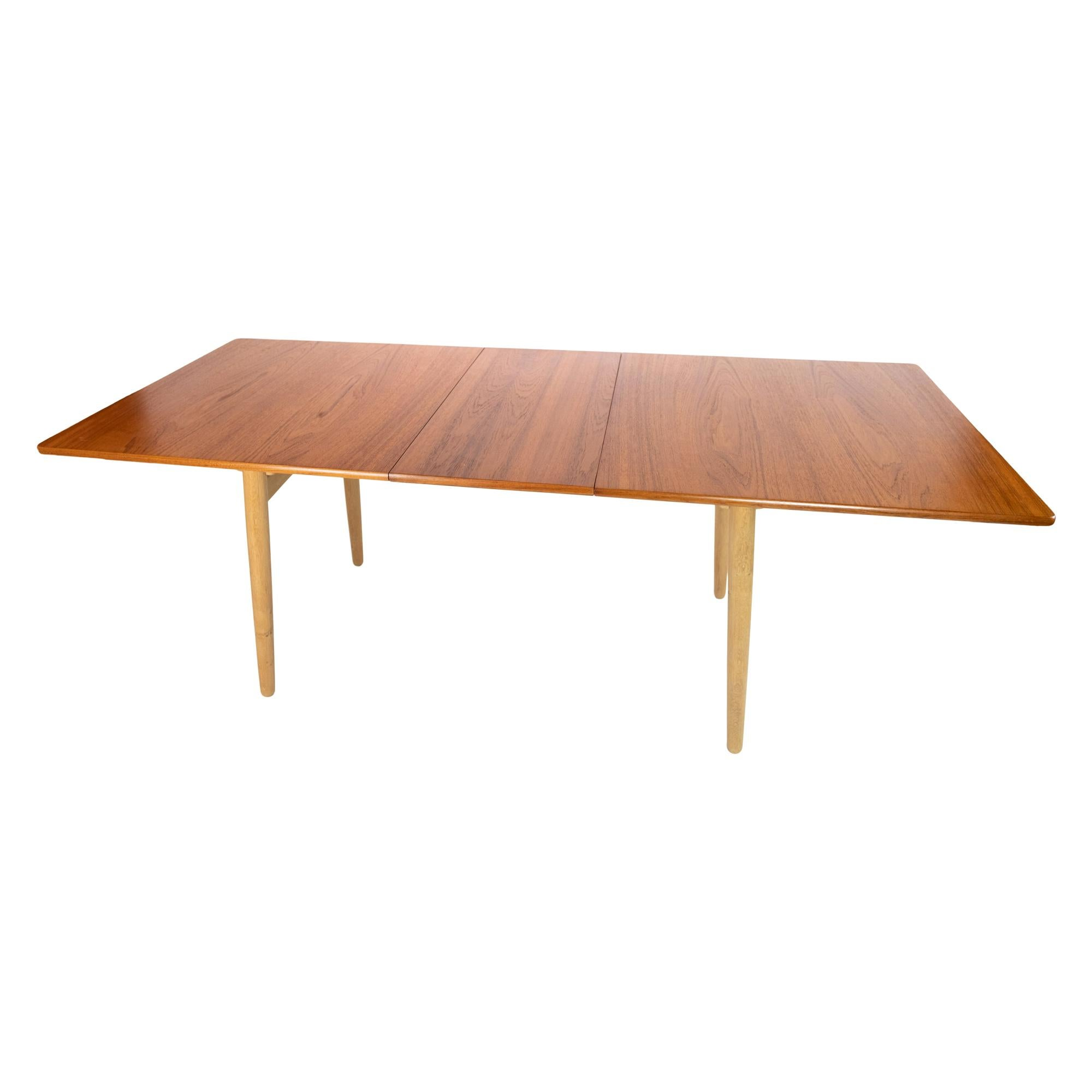 Dining Table in Teak and Oak with Extensions Designed by Hans J. Wegner
