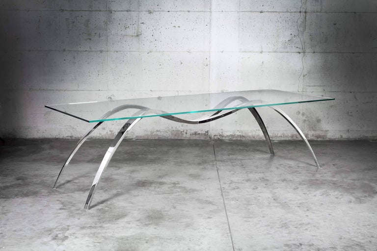 The Spider dining table is made of mirror polished stainless AISI 316 and tabletop in extra clear crystal glass. Dining table dimension: L 270, W 100, H 75cm. Each table is hand signed and numbered by the artists (engraved). 100% handmade in Italy,