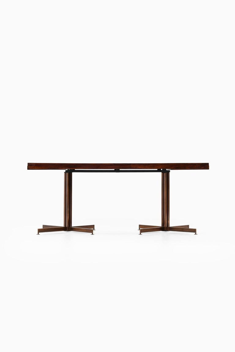 Rare dining table by unknown designer. Produced in Italy. Dimensions (W x D x H): 180,5 ( 256 ) x 84 x 72 cm.