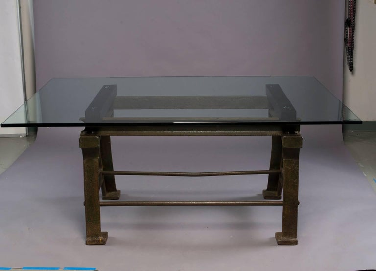 """Late 19th century iron industrial table base has traces of original green paint with black wood runners and a brand new, 3/4"""" custom glass top.  Base found in England. Measurements shown are with glass top. Base only measures:  29.5"""" high x 47"""" wide"""