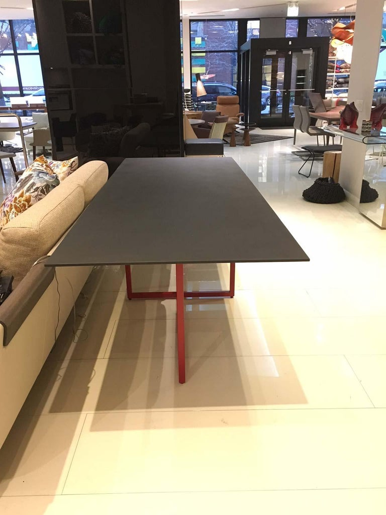A table that plays on an apparent imbalance, supporting a strong material top, by a sequence of three structures placed in a totally unpredictable way. Built as parallelepipeds and fixed either perpendicularly or parallel to the surface, the three