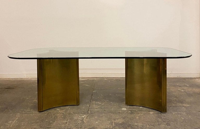Dining table with 2 brass pedestals by mastercraft.