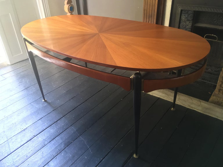 *** Holiday Sale ***  Dining table with sunburst top, attributed to Silvio Cavatorta, Italy, 1950s.  The oval design is very nicely made and well-proportioned to seat six. The table features a beautiful sunburst veneer to the top and a floating
