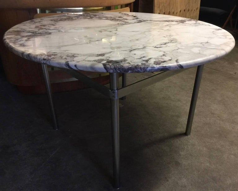 Has also laverne elements heavy marble base with wonderful grain resting on a matte chromed metal base.