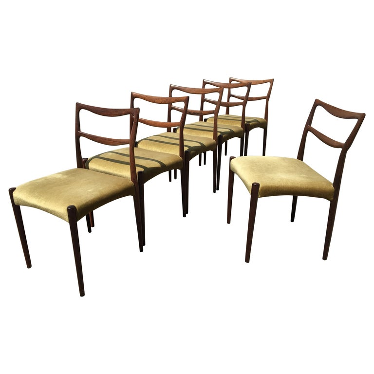 Dinning Chairs in Rosewood. Designer by H.W. Klein