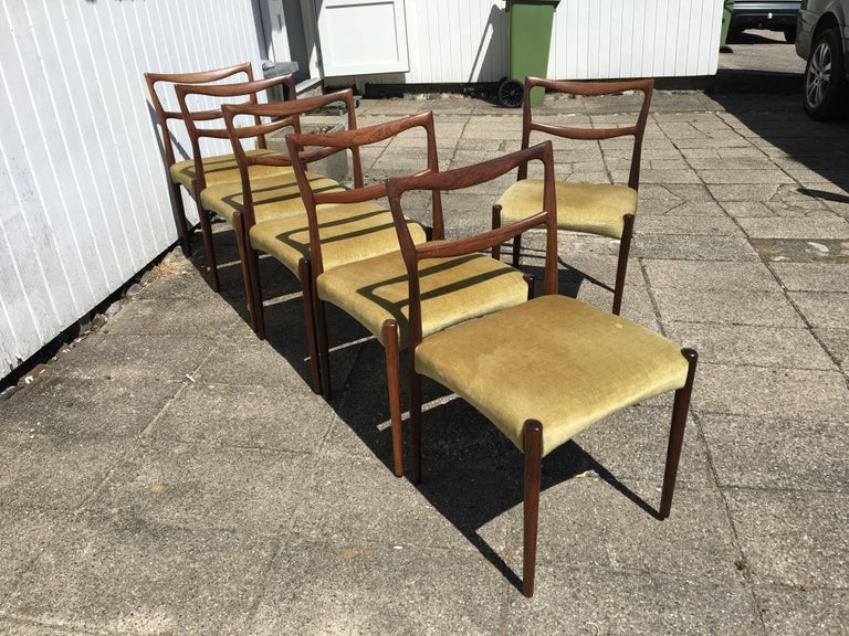 Mid-Century Modern Dinning Chairs in Rosewood. Designer by H.W. Klein