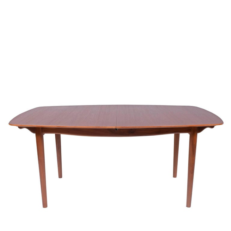 Great boat shape dining table design by Finn Juhl in 1950s for Baker furniture co. which have a many wrights to manufacture Juhls design for US market two leaves included. Metal label attached to the fame Two leaves 20