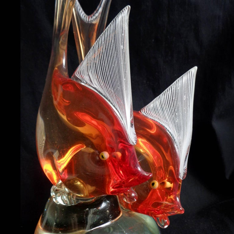 Beautiful Murano hand blown Sommerso orange Italian art glass double fish sculpture. Documented to designer Dino Martens for Aureliano Toso, circa 1954. Published in his book (see photo), model 6191. The fish have white Latticino ribbons on the fins