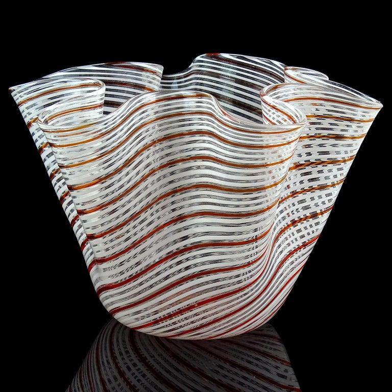 Beautiful Murano hand blown red orange and white Filigrana ribbons Italian art glass Fazzoletto handkerchief vase. Documented to designer Dino Martens for Aureliano Toso. Measures: 7 1/2