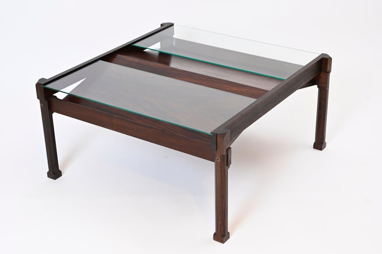 A striking Italian rosewood coffee table and magazine rack designed by Ico Parisi for Stildomus, The 'Dione' coffee table is catalogued as model number '1221' and was first designed by Parisi in 1959. The table is comprised of two sloping panels