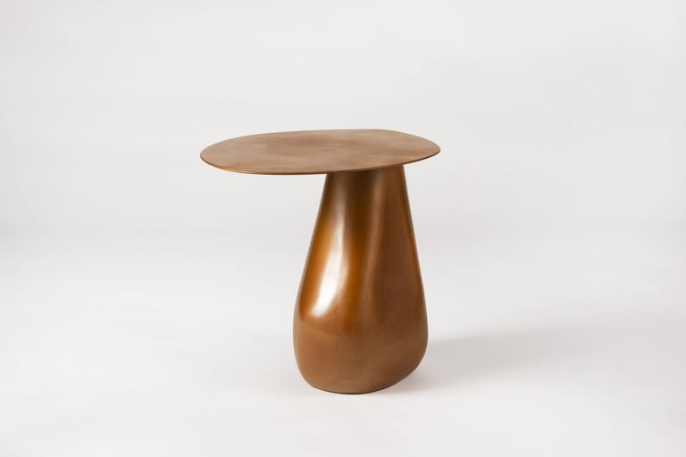 A signature piece from our stone collection, the expertly hand-sculpted Dionis side table evokes the subtle curves and contours of tumbled stones shaped by the ocean. This side table presents as sculpture yet functions as a table. Made by hand, each