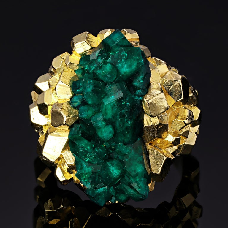 This incredible one of a kind ring showcases the natural beauty of the dioptase crystal, displaying it like a treasure-trove bursting with intense color in the center. Mined from Kazakhstan, this fine quality dioptase exhibits an intense