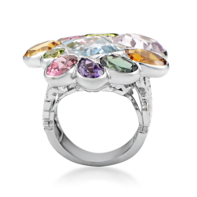 Boasting a vivacious and exuberant blend of diversely nuanced gems such as amethyst, citrine, peridot, kunzite, aquamarine and tourmaline falling into place tastefully to create a memorable sight, this exhilarating ring from Dior is made of