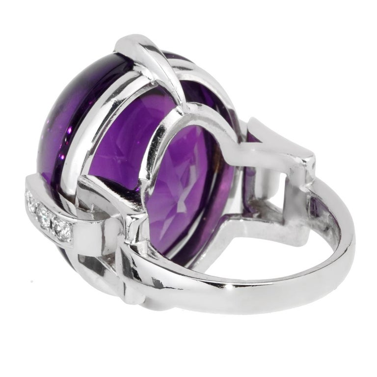 A magnficent Christian Dior diamond ring featuring an oval cabochon amethyst adorned with round brilliant cut diamonds in 18k white gold.