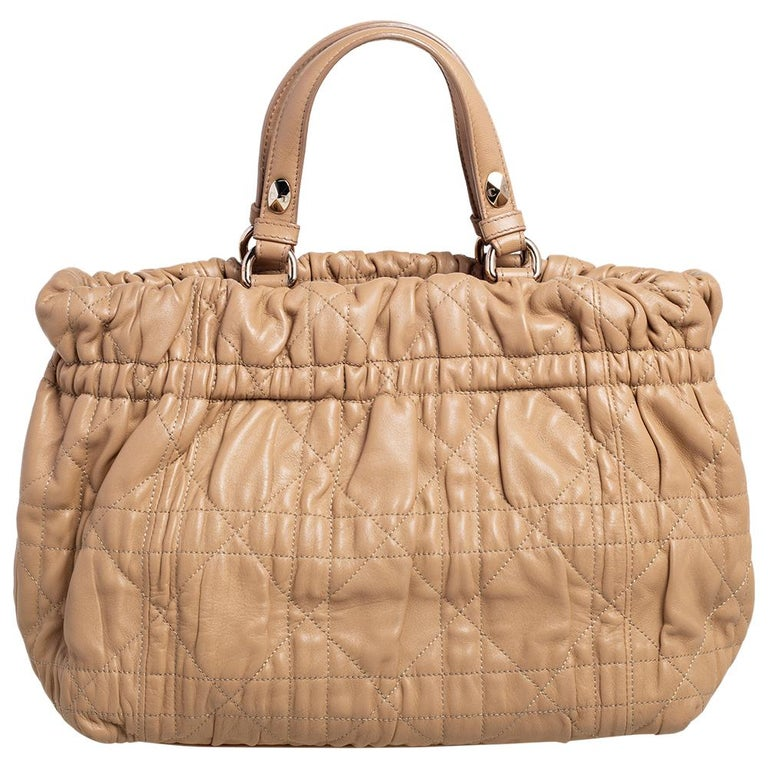 This beautifully stitched leather tote is by Dior. With a capacious leather-lined interior, it will house more than your essentials. Boasting two handles, a shoulder strap, and a fine finish, this tote offers style and everyday functional