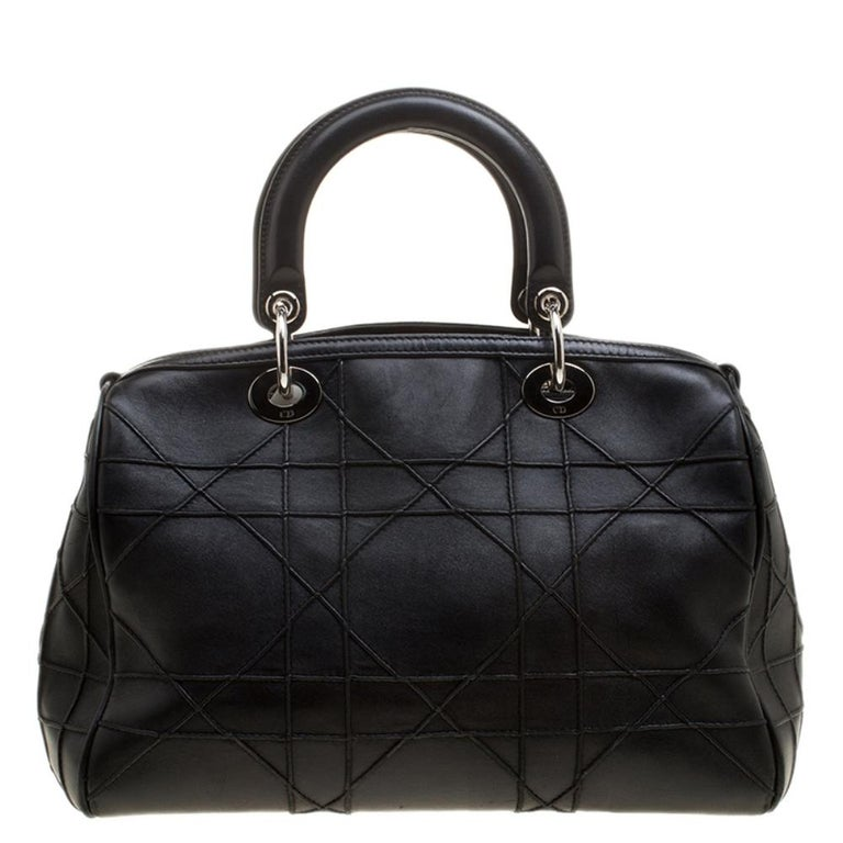 Fall in love instantly with this brilliant creation by Dior. Specially designed for the urban woman is this classic leather handbag with alluring features. Everything ranging from elegant design to breathtaking posh black color is just impeccable.