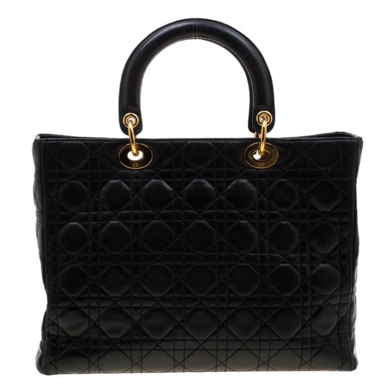 The Lady Dior tote is a Dior creation that has gained recognition worldwide and is today a coveted bag that every fashionista craves to possess. This black tote has been crafted from leather and it carries the signature Cannage quilt. It is equipped