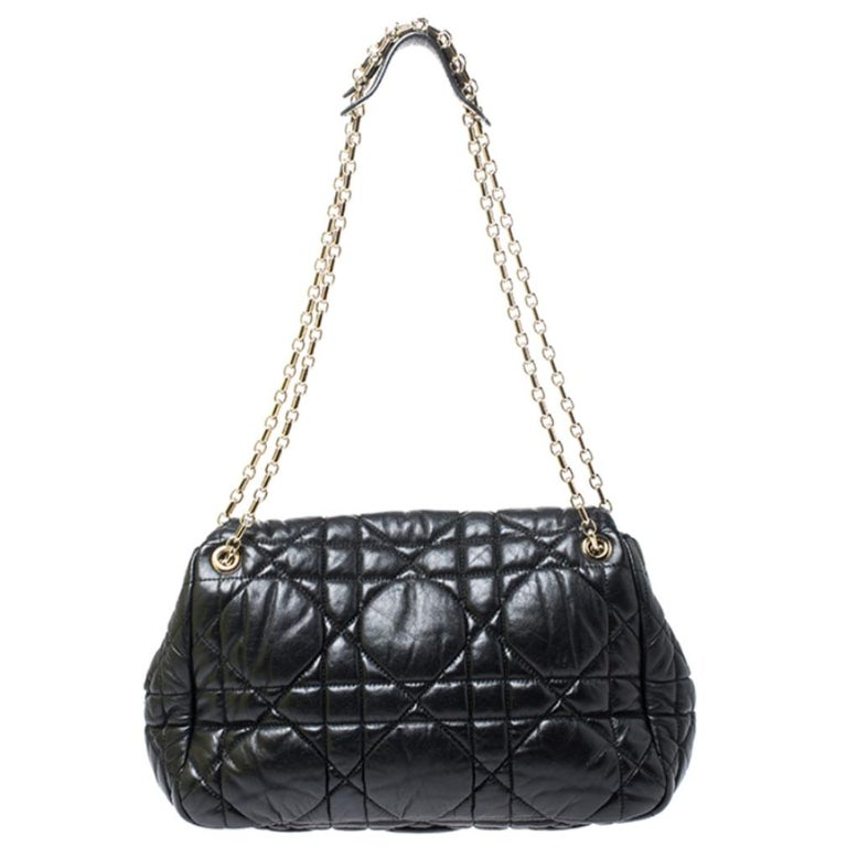 Add a classic bag to your wardrobe with this Dior shoulder bag. It is chic, reliable and will go with any of your outfits. It features Dior's signature cannage pattern on the black leather exterior, double chain handles with leather shoulder rests