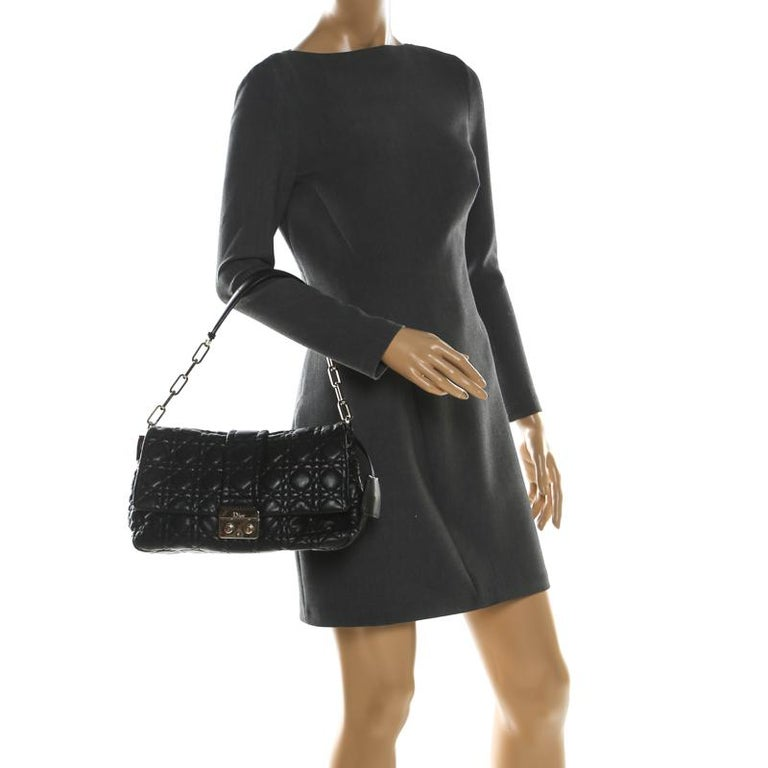 This Dior flap bag was named after 'New Look' which was actually coined by Christian Dior himself. Dazzling in a gorgeous black shade, the bag is crafted from leather in their Cannage pattern and designed with a single handle and a front lock. The