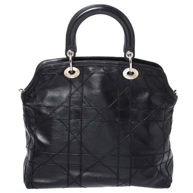 This chic and feminine Granville tote is from Dior. The bag is crafted from Cannage quilted leather. Black in colour, it is easy to carry around. It features dual handles with the signature 'DIOR' accents and protective metal feet. The interior is