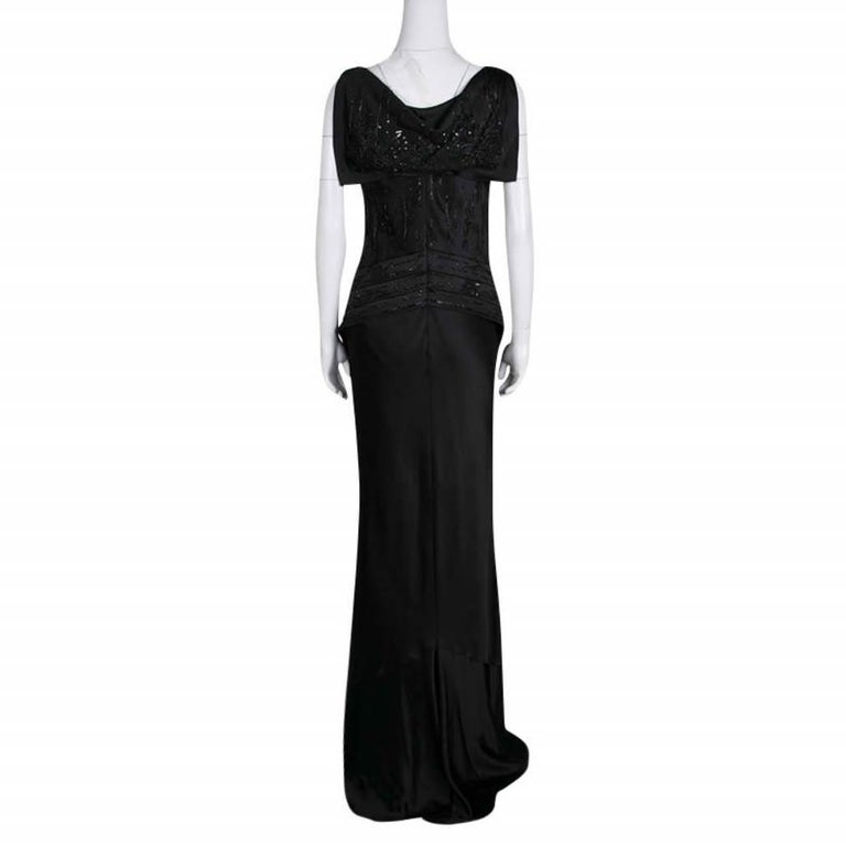 Elegance and style are brought together in this sleeveless gown from Dior. Designed to give you a statement look, this black outfit has an embellished bodice with subtle drape details and a modishly designed rear. It exudes a classy finish with its