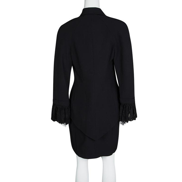 It's time you got a gorgeous blazer and skirt set and what better than this one from Dior. The set is made of the finest materials and features an elegant design. The blazer comes with front buttons, long sleeves with lace cuffs and a V cut back. A