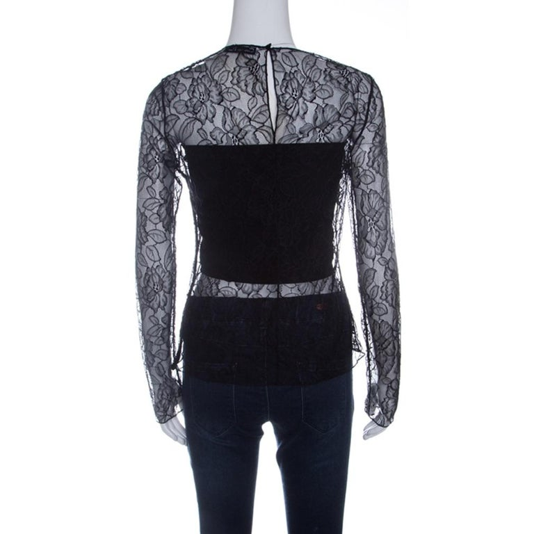 There is something incredibly chic, feminine and flattering about lace just like this Dior top. It features a floral lace body with full sleeves and shows just the right amount of skin. It features a rounded neckline and secured with a hook closure