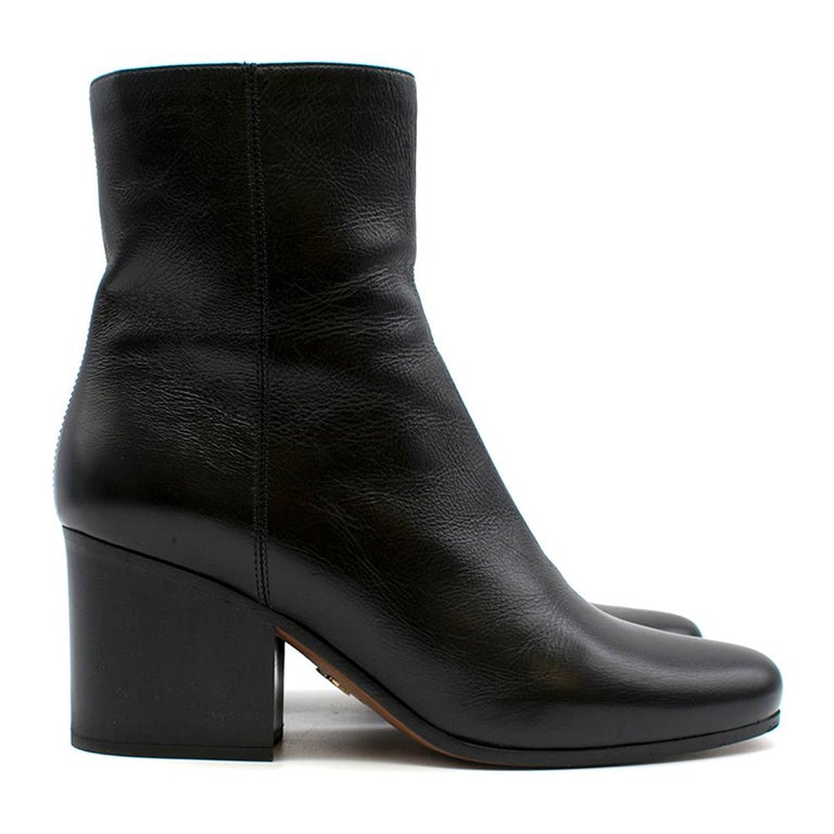 Timeless design black leather ankle boots with almond-toe and 7cm heel.  -Side zip (Both in a good condition) -7cm block heel -Made in Italy  Please note, these items are pre-owned and may show signs of being stored even when unworn and unused. This