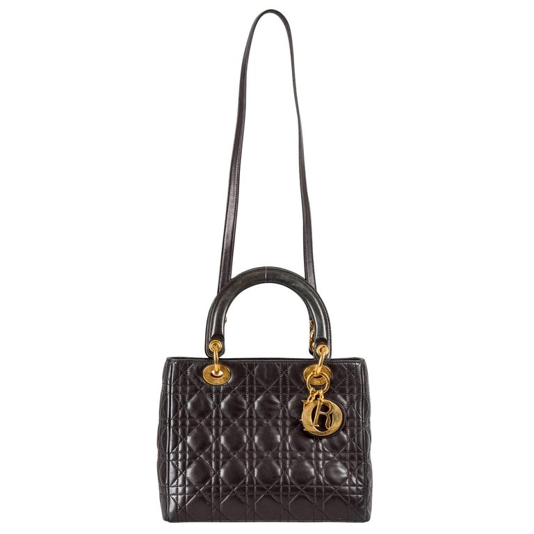 The Lady Dior tote from Dior is iconic, highly coveted, and since its birth in 1994, it has swayed us with its shape, design, and beauty. This version is a joy to witness! It comes meticulously crafted from black leather and designed with their