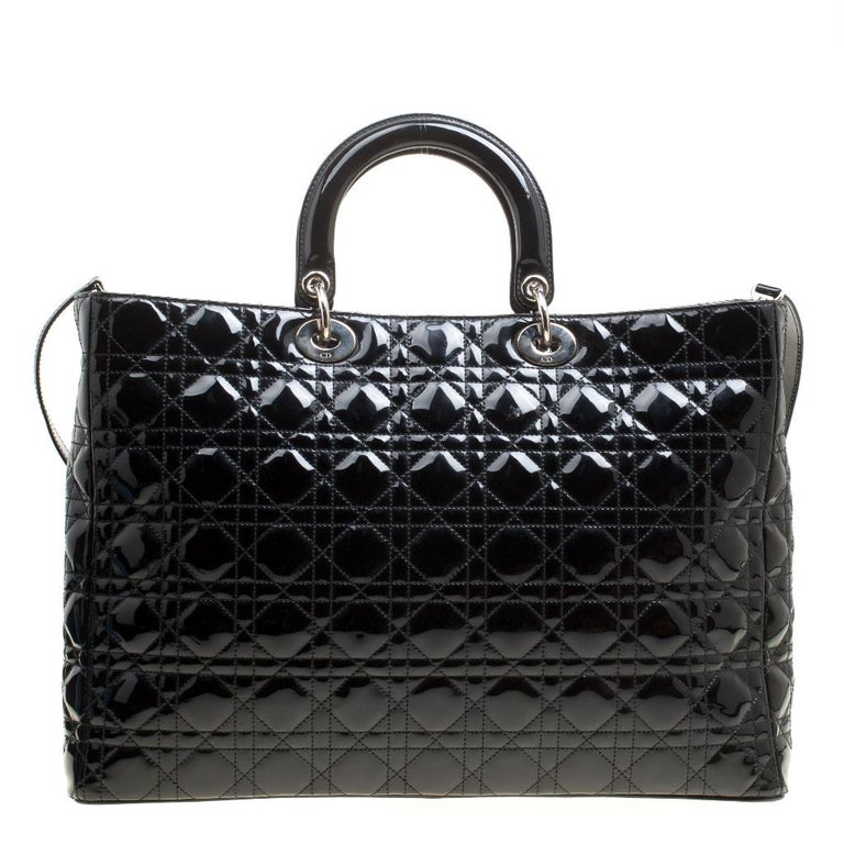 The Lady Dior bag is a Dior creation that was designed in 1994 and has gained lovers worldwide. Crafted from black leather this bag carries a cannage pattern exterior. It is equipped with dual rolled top handles, a shoulder strap, classic Dior