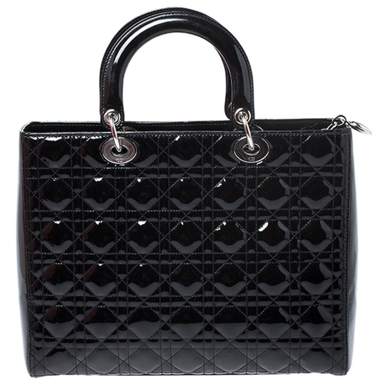 The Lady Dior tote is a Dior creation that has gained recognition worldwide and is today a coveted bag that every fashionista craves to possess. This black tote has been crafted from patent leather and it carries the signature Cannage quilt. It is