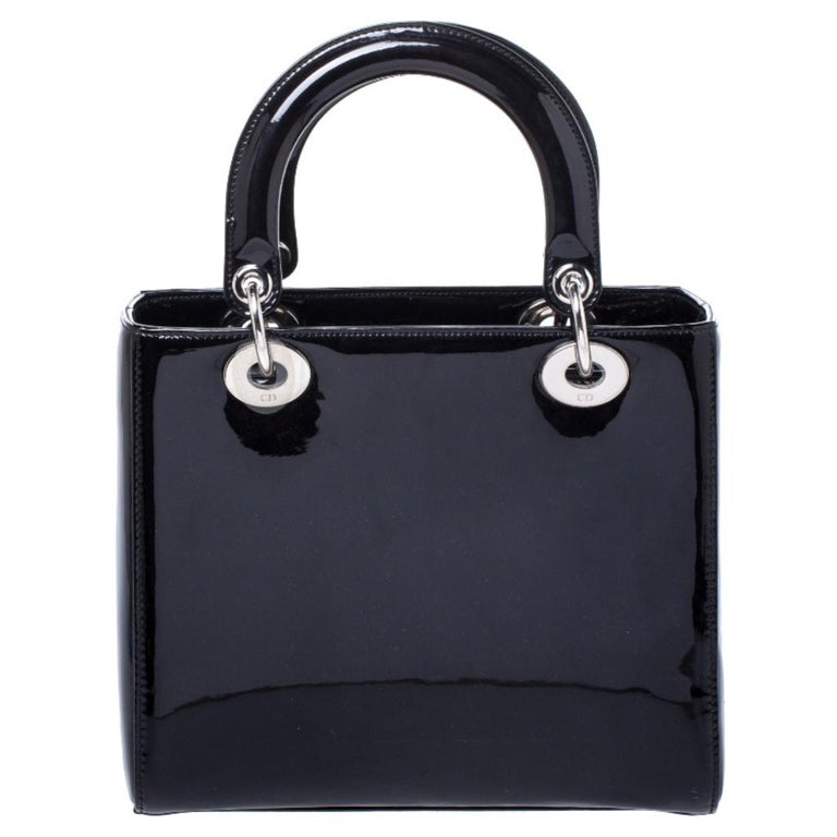 The Lady Dior tote is a Dior creation that has gained recognition worldwide and is today a coveted bag that every fashionista craves to possess. This black tote has been crafted from patent leather. It is equipped with a leather interior and two top