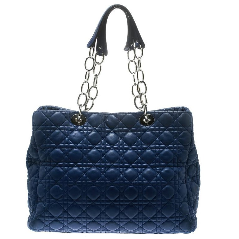 This shopper tote from Dior is a timeless piece. The bag is crafted from luxurious blue quilted leather and has the cannage pattern. It features double top handles, protective feet at the bottom and Dior letter charm in silver tone. A buttoned