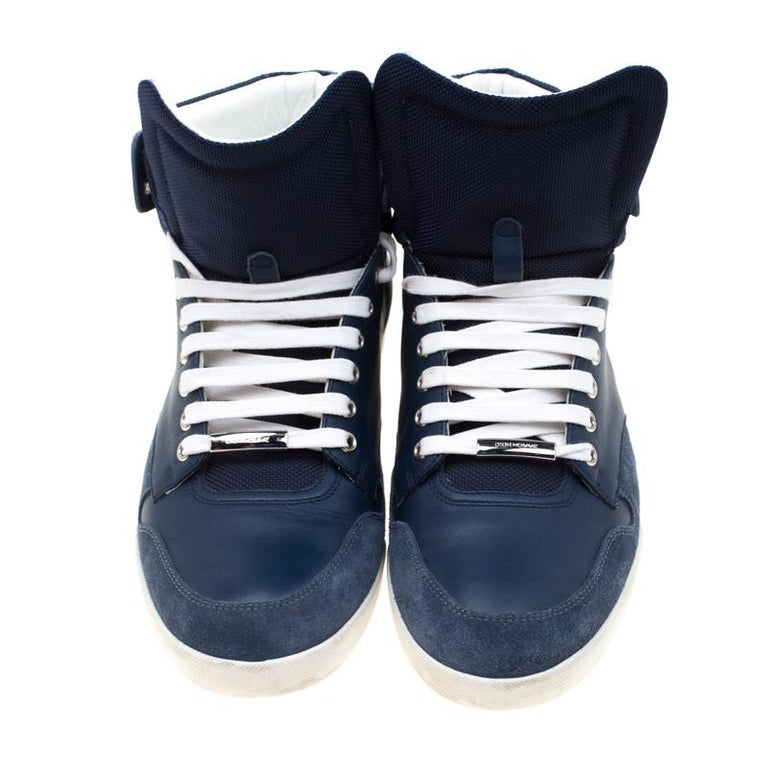 The clean-cut look in these sneakers is created with the blue and white leather exterior; and finished off with suede and leather trims. The white laces feature engraved Dior Homme plaques matching with the silver-tone eyelets. Lined with leather,