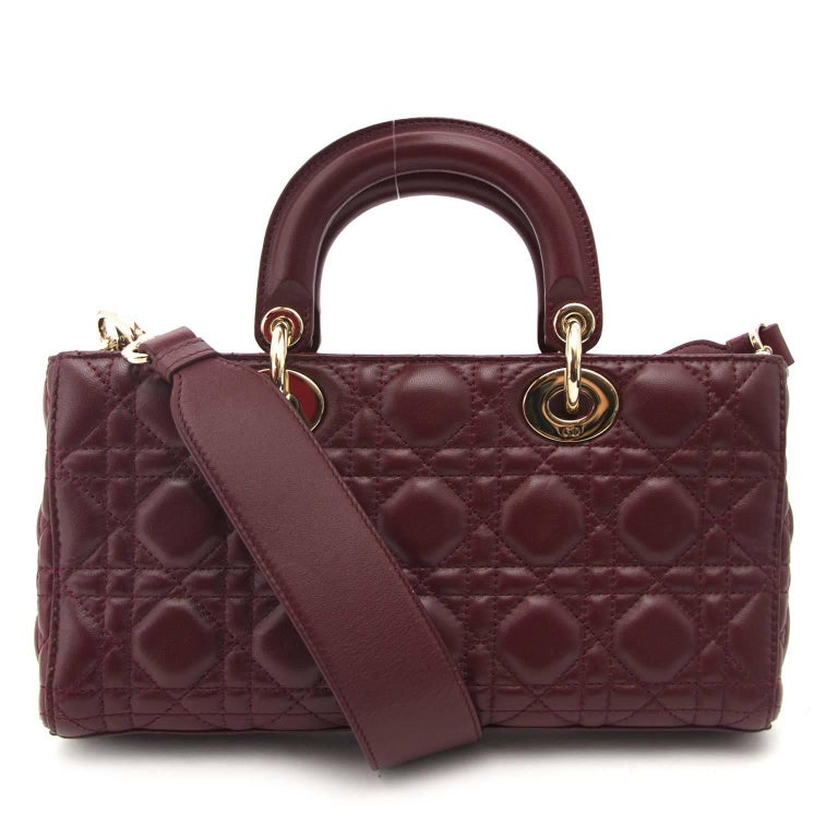 Excellent condition  Estimated retail price: €2,300  Dior Bordeaux Lambskin Runway Bag  This amazing Dior runway bag is made out of the finest leahter. The gold details are a perfect match with the bordeaux color. The typical Dior letters give a