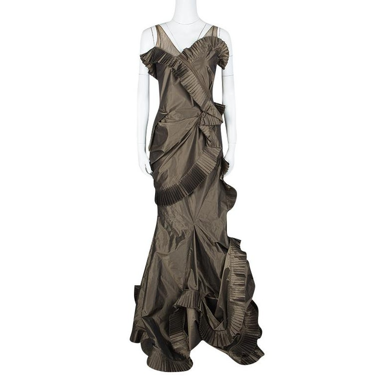 This Dior gown could not be any more perfect for you as it is overflowing with exquisiteness. Made from the finest materials, it flaunts a tiered style with swirling ruffles, pleats and a skirt falling gracefully to the floor. If you wish to look