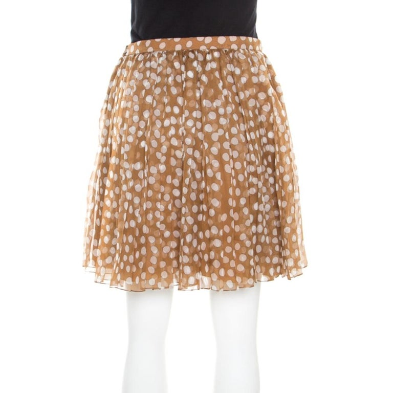 You'd definitely want to be seen wearing this skirt from Dior! Finely made from quality silk, this chiffon creation has polka dots all over and a gathered waistline. You can team it with an off-shoulder top and high heels to look amazing.  Includes: