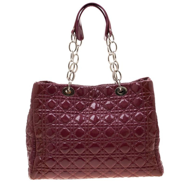The Lady Dior tote is a Dior creation that has gained recognition worldwide and is today a coveted bag that every fashionista craves to possess. This burgundy tote has been crafted from soft leather and it carries the signature Cannage quilt. It is