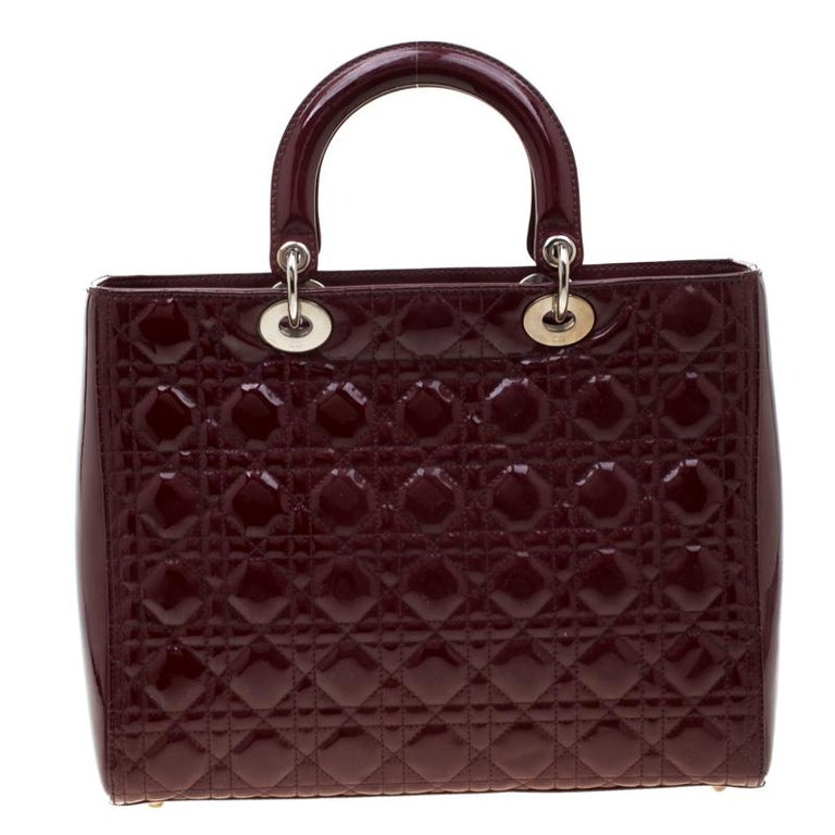 The Lady Dior tote is a Dior creation that has gained recognition worldwide and is today a coveted bag that every fashionista craves to possess. This burgundy tote has been crafted from patent leather and it carries the signature cannage quilt. It