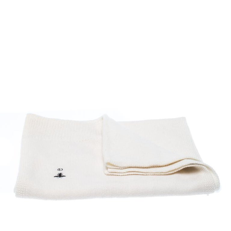 This lightweight cashmere scarf by Dior will add a touch of sophisticated style to your ensemble. It comes in a soft cream hue with a little embroidered detail. Cut to a generous length, it is designed with hemmed edges for a seamless