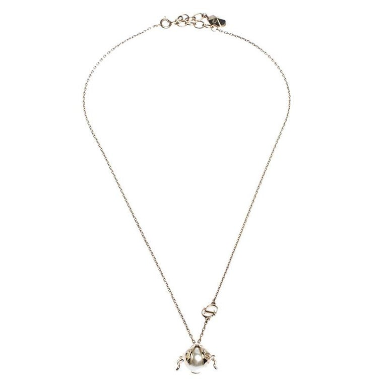 Simplicity is the ultimate sophistication and this pendant necklace from Dior aptly justifies that. The necklace is crafted from gold-tone metal and comes with a sleek chain and a beautiful pendant. The pendant features an embellished ladybug design