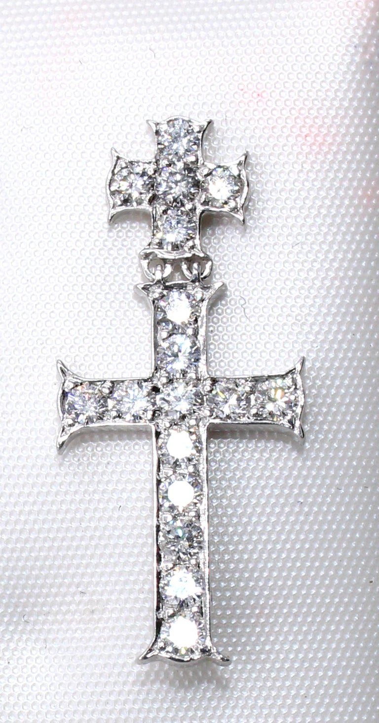 Beautifully designed and masterfully handcrafted in 18 karat white gold, this flexible double-cross lapel pin/pendant makes a chic statement on any jacket or blouse. Set with 17 perfectly matched white bright and sparkly round brilliant cut