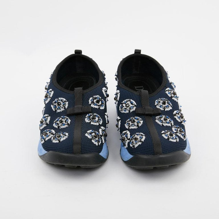 Flagship model of the year 2014, by Raf Simmons, pair of sneakers DIOR, Fusion model, in dark blue canvas without lace. Size 38.5.  The sole is in blue rubber. Beads flowers are embroidered on the canvas. They are in very good condition and have