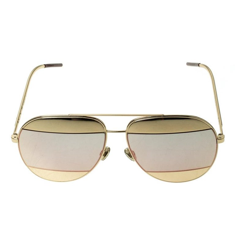 From their Split 1 collection, these aviator sunglasses by Christian Dior are the perfect style accessory for all your outdoor plans. They come in a gold-tone metal body with metal inserts in the lenses and the signature logo CD on the