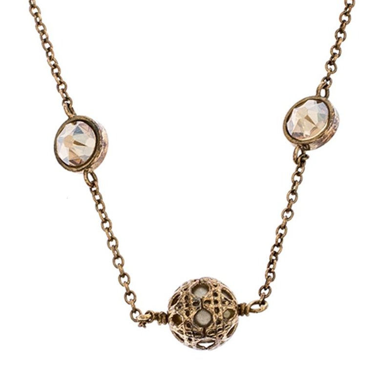 This beautiful Dior necklace is a lovely everyday piece. Designed in gold-tone metal, this piece comes with a Cannage-designed metal pendant along with two stones and the 'CD' logo attached to the chain. Secured by a spring-ring closure, the size