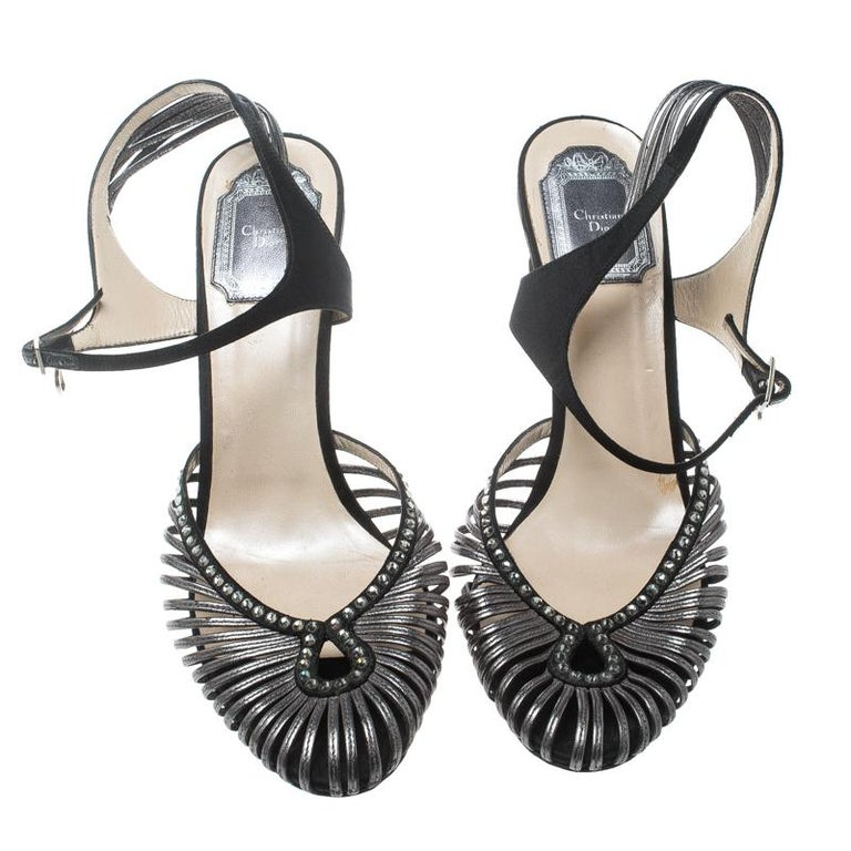 eb65d91a989 These Dior sandals will grab everyone s attention with their distinctly  feminine design. Crafted from grey